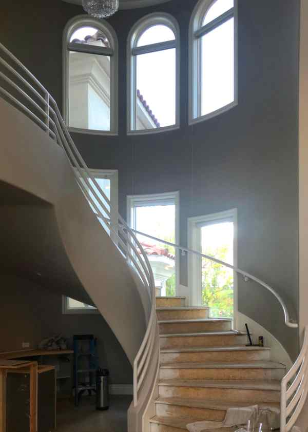 photo of home showing spiral staircase with several windows using nightvision 15% film